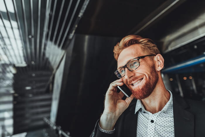Man on the phone. With Zylinc, your call center agents and receptionists can handle inquiries via phone, chat, e-mail, and social media in a single multi-channel solution.